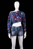Floral crop top and shorts. Blue crop top on mannequin. Fashionable summer look for girls. Stylish pattern clothing on sale Royalty Free Stock Photography
