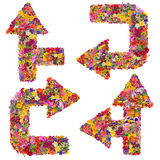 Floral curved arrows set. Symbols of the abstract curved arrows are made of fresh summer flowers. Isolated handmade collage vector illustration