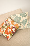 Floral cushions. Two creative cushions sitting on a cream sofa Royalty Free Stock Images