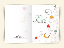 Floral decorated beautiful greeting card for Eid Mubarak. Stock Image