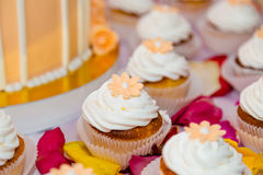 Floral decorated cupcakes. Sweet cupcakes on the table Royalty Free Stock Photos
