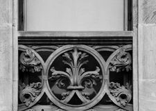 Floral decoration on the balcony is special. Shot and black and white, detail on the sculpture on the facade of this historic building representing some plants Royalty Free Stock Photo