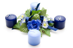 Floral decoration with blue candles Royalty Free Stock Images