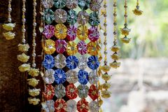 Floral decoration in buddhist temple. Cambodian temple internal floral decor. Buddhism festival decoration.