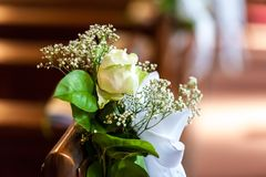 Floral decoration in church on wood bench stock image