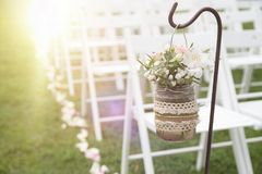 Floral decoration next to aisle in a wedding celebration. Floral decoration next to aisle in a wedding celebration in a church garden. Empty copy space for stock photos