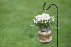 Floral decoration next to aisle in a wedding celebration. Empty copy space for Editor`s text royalty free stock images
