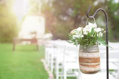 Floral decoration next to aisle in a wedding celebration. Empty copy space for Editor`s text royalty free stock photo