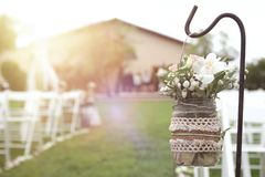 Floral decoration next to aisle in a wedding celebration. Floral decoration next to aisle in a wedding celebration in a church garden. Empty copy space for stock image
