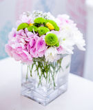 Floral Decoration on table at a wedding. Shallow Depth of Field.  Stock Photography