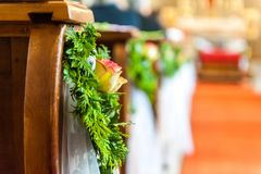 Floral decoration on wood bench in church stock photos