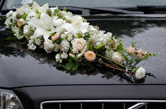 Floral decorations on black wedding machines bonnet. Stock Photo