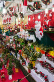 Floral decorations and traditional gifts  in Christmas market Royalty Free Stock Photo
