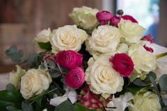 Floral decorations at the wedding ceremony. Bouquette of roses. Assorted Ideas for Florals used in the wedding ceremony either inside. Floral arrangements Stock Photos