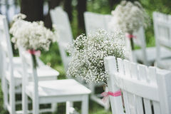 Floral decorations wedding chairs Stock Photo