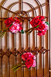 Floral decorations. Wrought iron gate with floral decorations pink and red Royalty Free Stock Image