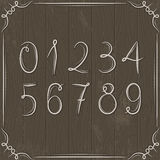 Floral decorative borders and numbers on wooden ba Stock Photo