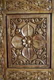 Floral Design. Exquisitely carved floral design on wooden door panel Royalty Free Stock Images