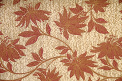 Floral designs on fabrics. Brown and abstract floral designs on fabrics stock image