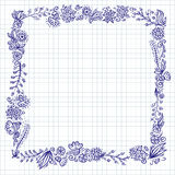 Floral doodle frame on checkered notebook paper Royalty Free Stock Photos