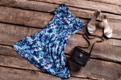 Floral dress and black handbag. Stock Image