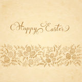 Floral elements and lettering Happy Easter on beige background Royalty Free Stock Photography