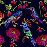 Floral embroidery. Seamless vector pattern with birds, berries and flowers. Royalty Free Stock Photos
