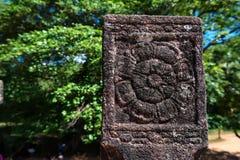 Floral ethnic patten in sandstone in Sri Lanka. Srilankan ancient floral pattern carved in sandstone. Polonnaruwa, Sri Lanka Royalty Free Stock Image