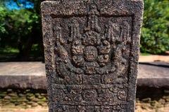 Floral ethnic patten in sandstone in Sri Lanka. Srilankan ancient floral pattern carved in sandstone. Polonnaruwa, Sri Lanka Royalty Free Stock Images