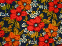 Floral fabric. Pretty floral fabric with red flowers suitable as background Royalty Free Stock Photos