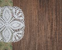 Floral fabric and lace on old wood background. Floral fabric and lace on the old wood background stock photos