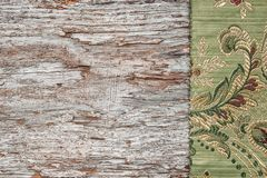 Floral fabric on the old wood. Background royalty free stock images