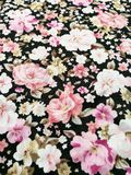 Floral fabric texture background. With white and pink rose pattern royalty free stock photo