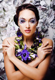 Floral face art with anemone in jewelry, sensual young brunette Royalty Free Stock Photos