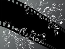 Floral film. Vector illustration of a black film strip and swirls with leaves and flowers Royalty Free Stock Photography