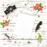Floral flat lay sketchbook photo camera pink flowers Stock Image