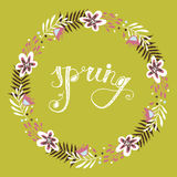 Floral frame. Beautiful  wreath made of hand drawn leaves and flowers and text Spring. Stock Photos