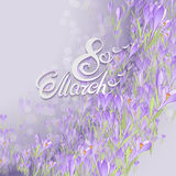 Floral frame with crocuses and  snowdrops. Purple background Stock Image