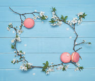 Floral frame and dessert macaroons on a blue wooden background Stock Photography