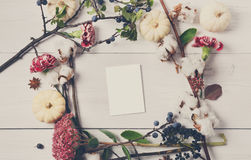 Floral frame of dried flowers on white wood, Top view. Stock Photos