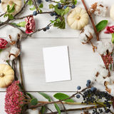 Floral frame of dried flowers on white wood, Top view. Stock Photo