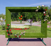 Floral frame for photos in the city park. Nfloral frame for memorable photos of the town park visitors Royalty Free Stock Photography