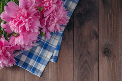 Floral frame with pink peonies on wooden background Stock Images