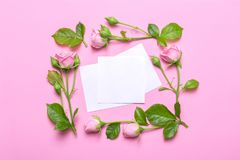 Floral frame with pink roses on a pink background. Borders of flowers with empty place for text. Floral frame with pink roses on a pink background. Corners Royalty Free Stock Image