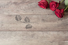 Floral frame with red roses on wooden background. Styled marketing photography. Copy space. Wedding, gift card Royalty Free Stock Image