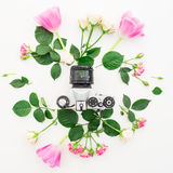 Floral frame with tulip flowers, roses and retro camera isolated on white background. Flat lay, Top view. Pattern with tulip flowers, roses and retro camera on Stock Images
