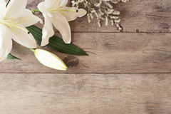 Floral frame with white calla, lilies on wooden background. Styled marketing photography. Copy space. Wedding, gift card Royalty Free Stock Photo