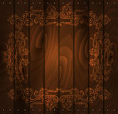 Floral frame on wood background Stock Photos
