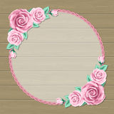 Floral frame on wooden background Stock Photo