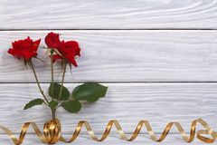 Floral frame on a wooden background Royalty Free Stock Image